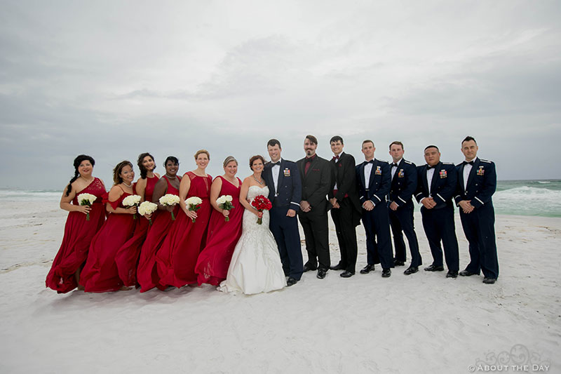 Full Wedding party during wind storm at Princess Beach in Destin, Fl