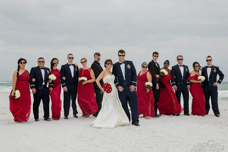 Full Wedding party poses during wind storm at Princess Beach in Destin, Fl