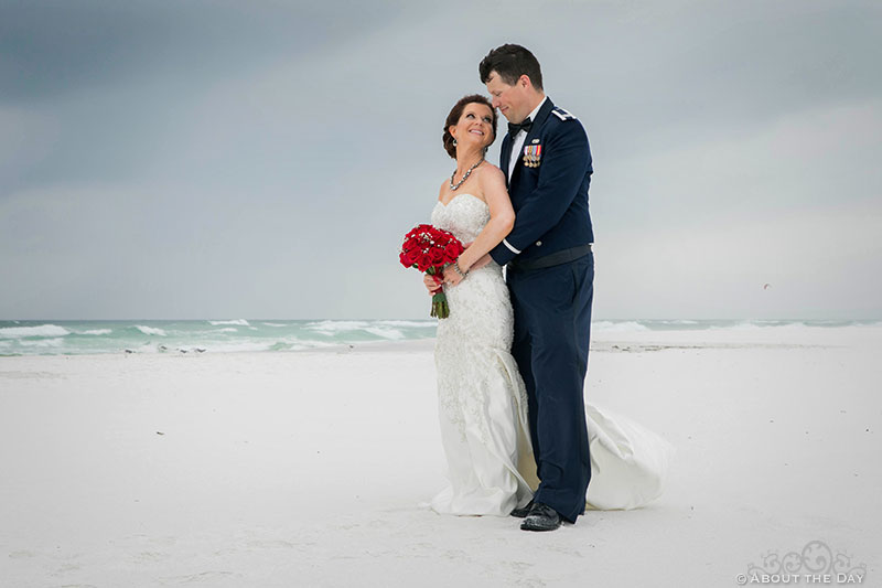 Josh and Rebecca look at each other during windstorm at Princess Beach in Destin, Fl