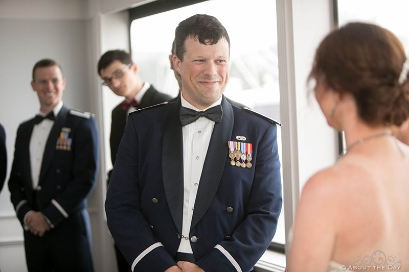 Josh grins at Rebecca during wedding ceremony on the Solaris Yacht in Miramar Beach, FL