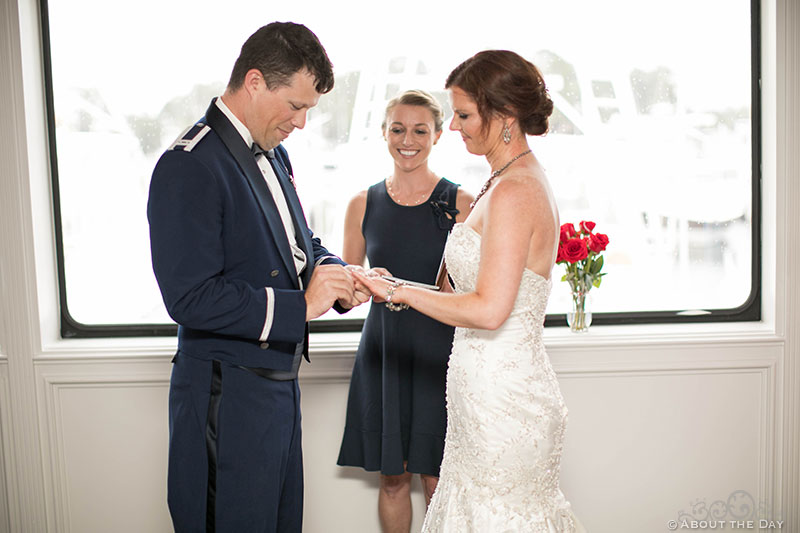 Bride and Groom exchange rings on the Solaris Yacht in Miramar Beach, FL