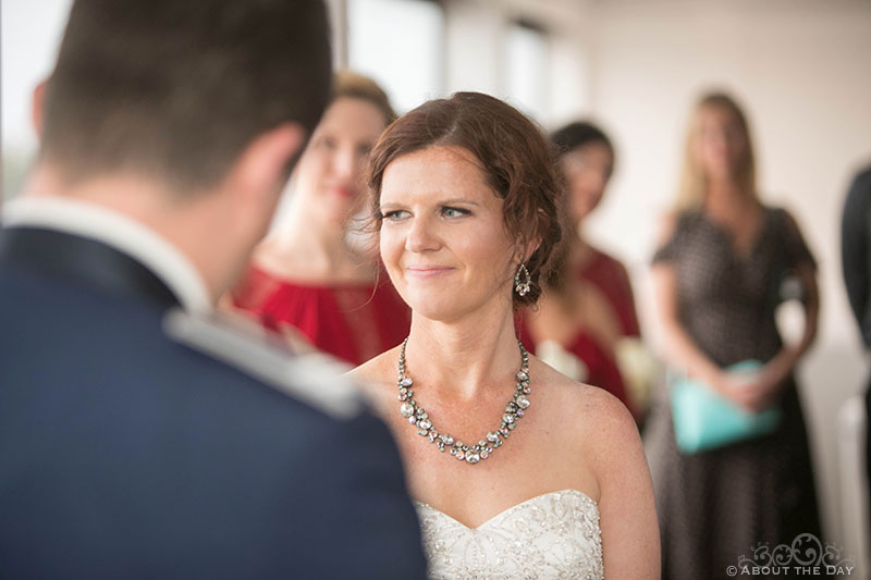 Rebecca smiles during wedding ceremony on the Solaris Yacht in Miramar Beach, FL