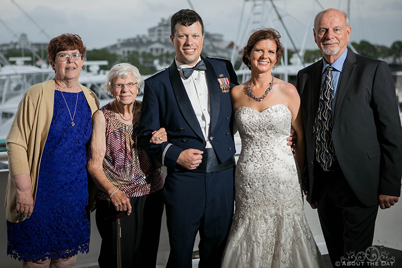 The Wedding couple with their parents and grandmother