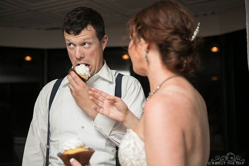 Groom tries to eat his own cake before it's pushed in his face