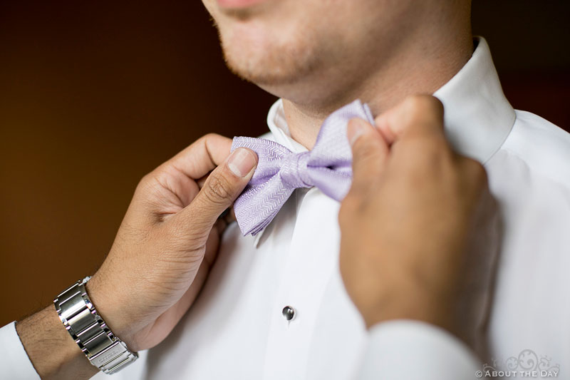 Father adjusts Grooms bow tie