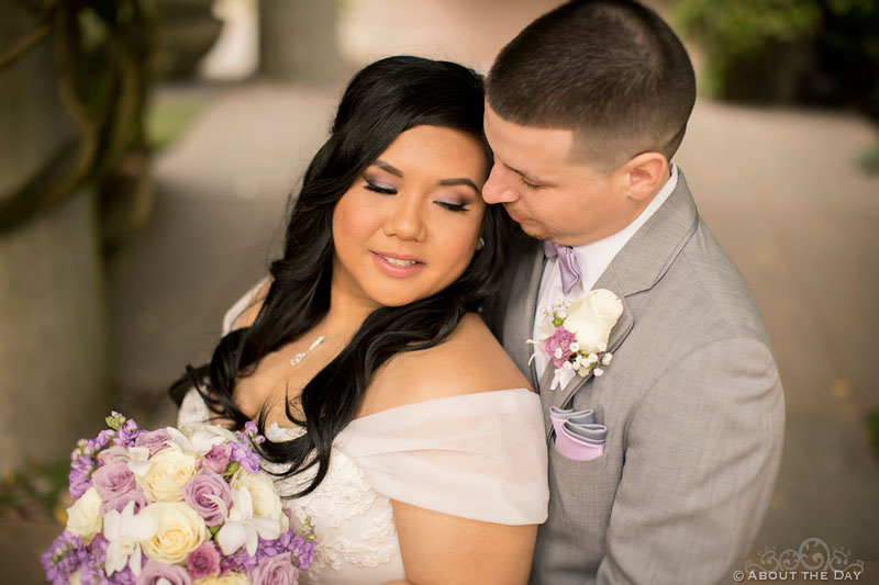 Bride and Groom in the arbor at the Harbor Club in Bellevue Washington