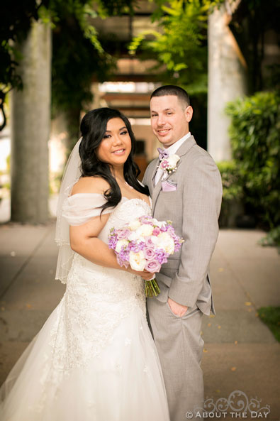 Bride and Groom pose out front of the Harbor Club in Bellevue Washington