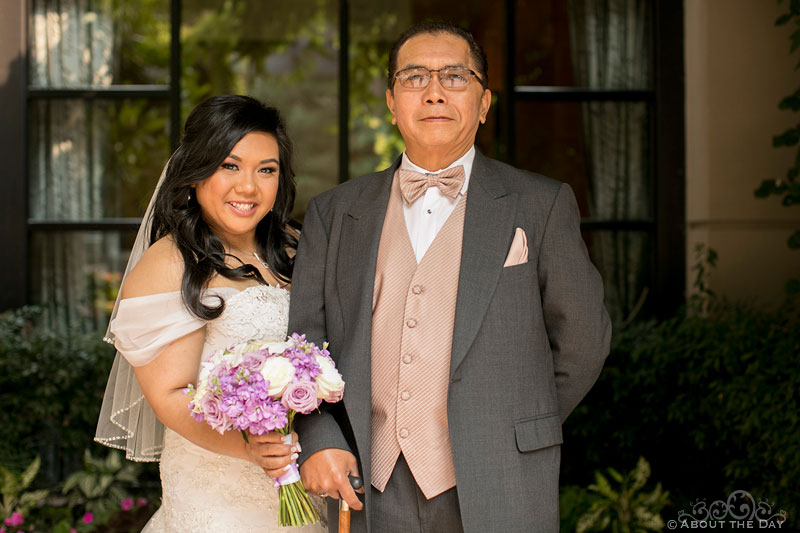Bride and her father in front of the Harbor Club in Bellevue Washington