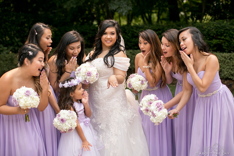 Bride shows her ring to the adoring Bridesmaids
