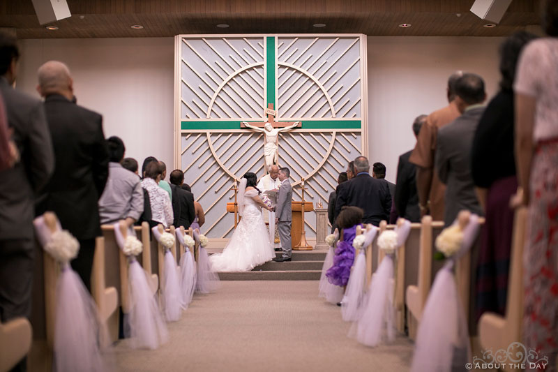 Wedding vows at St. Stephen the Martyr Catholic Church