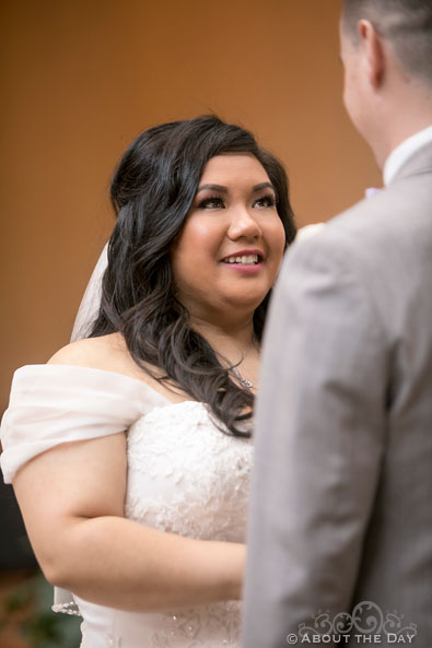 The Bride says her vows at St. Stephen the Martyr Catholic Church