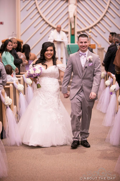 Bride and Groom exit down the Isle at St. Stephen the Martyr Catholic Church