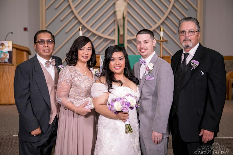 Bride and Groom with their parents at St. Stephen the Martyr Catholic Church