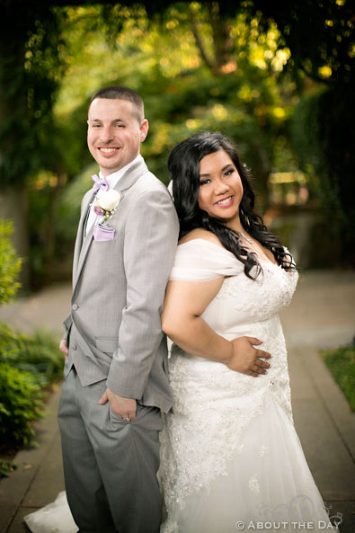 Bride and Groom back to back at the Harbor Club in Bellevue Washington