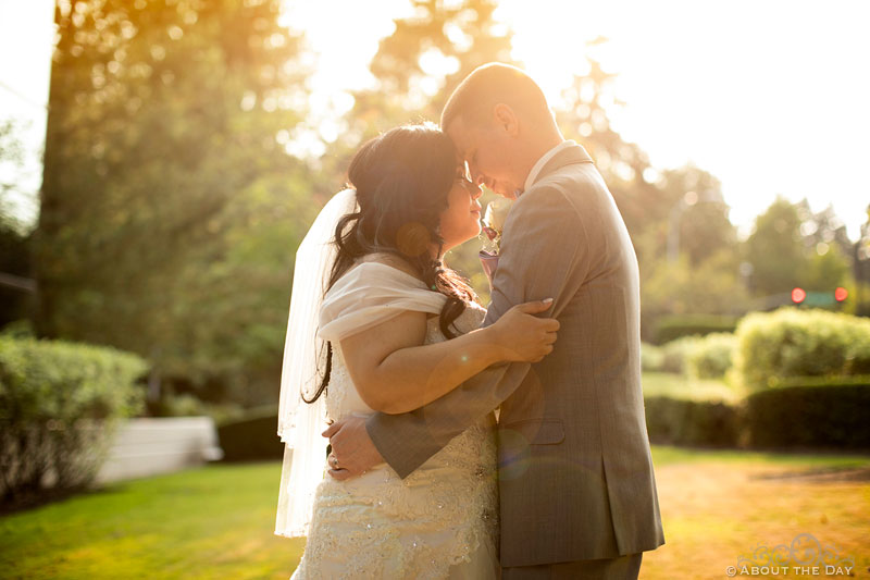 Bride and Groom kissing in the sun glow