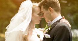 Wedding Couple in sunlit glare at Thunder Island