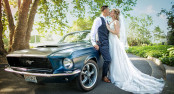 Douglas & Courtney kiss in front of their Mustang