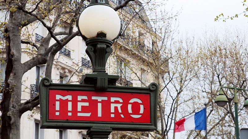 Coming up to street level and seeing the Paris metro sign
