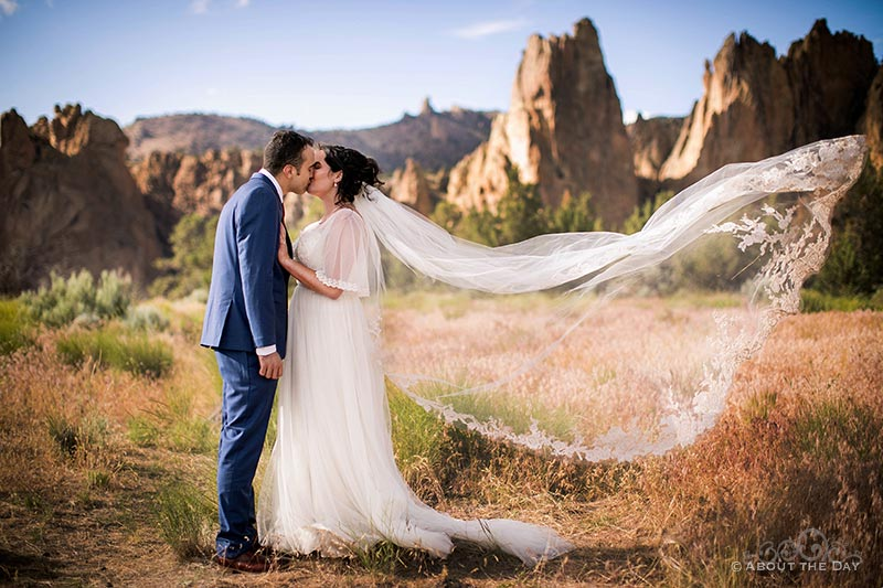 Connor & HannahShae kiss while wind takes her veil at Smith Rock