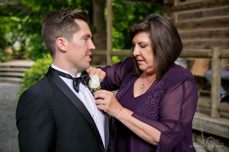 Mom helps Groom with his flower