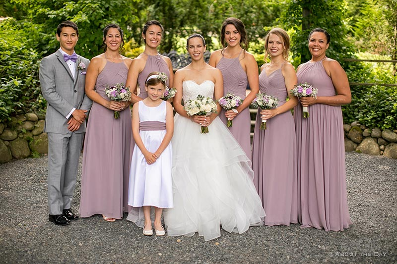 Tori and her wedding party with flower girl