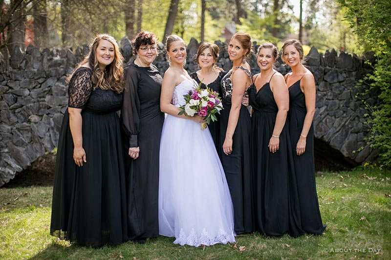Bride with all the girls on a stone bridge in Manito Park