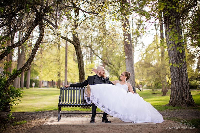 The Bride & Groom relax on a bench in Manito Park