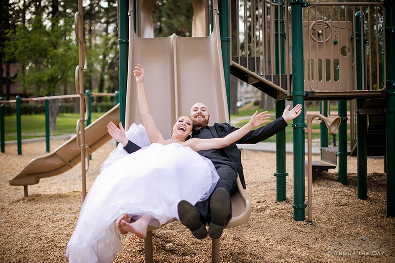 The Bride & Groom use a kids slide in Manito Park