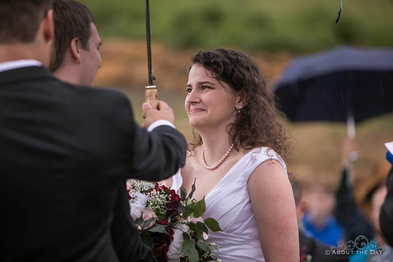 Lauren says her vows in rain soaked wedding ceremony at the Legacy Estate Vineyard