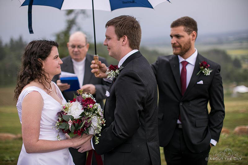 Rain soaked wedding ceremony at the Legacy Estate Vineyard