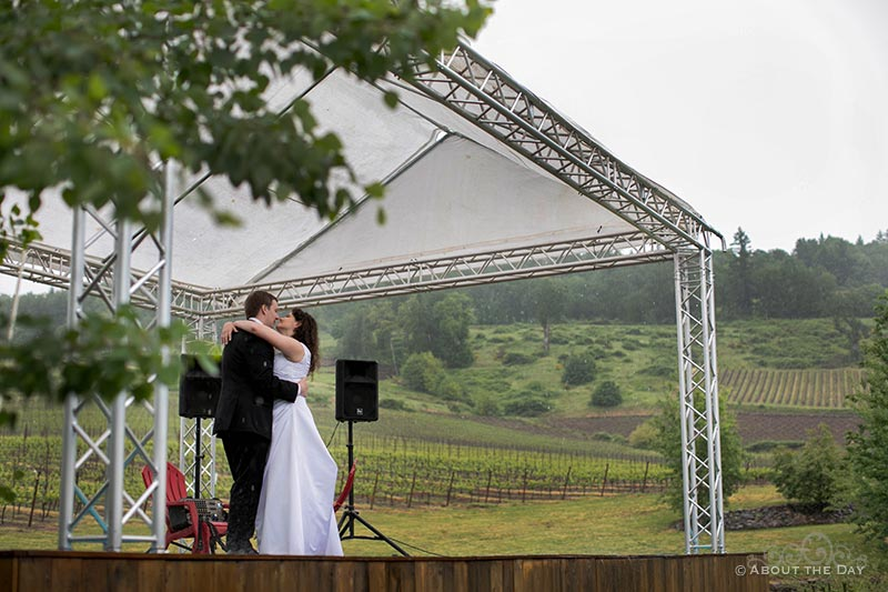 The bride and grooms first dance in the rain at the Legacy Estate Vineyard