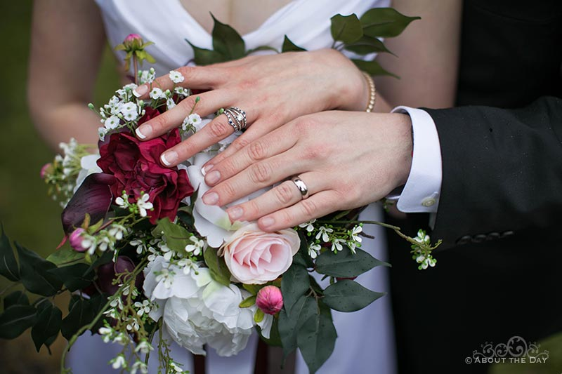 The bride and grooms rings and flowers
