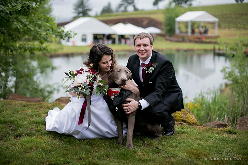 Lauren & Steven and their dog with a view of the reception in the back