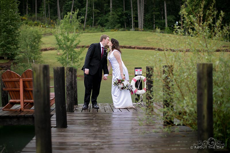 The Bride & Groom kiss on the dock at Legacy Estate Vineyard