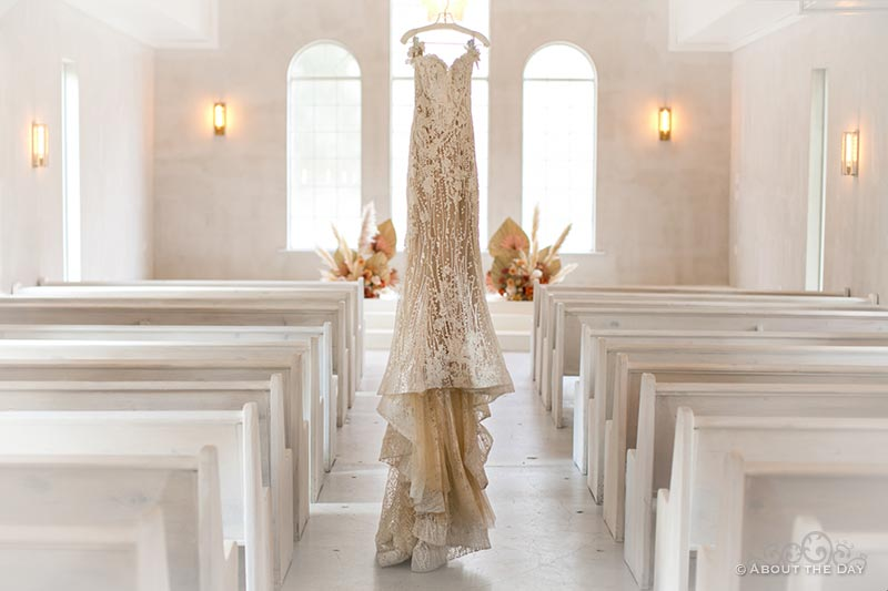 Kacie's wedding dress hangs in The Emerson Chapel